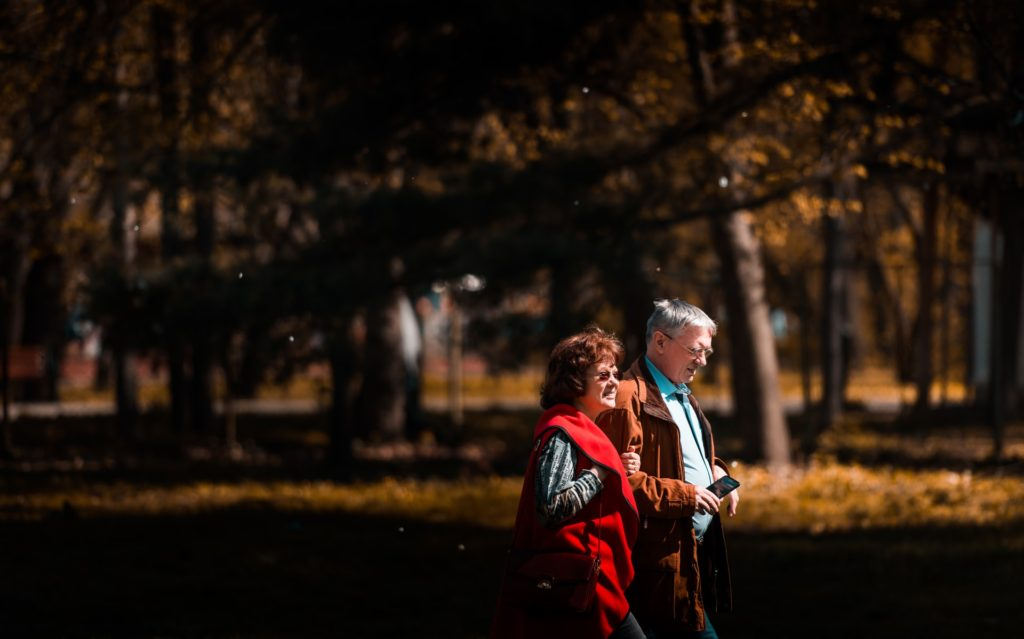 Retired couple discussing Medicare options